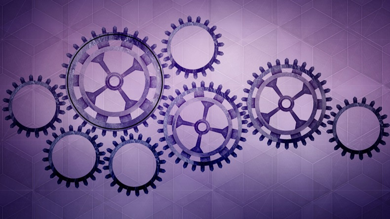 Cogs on purple background