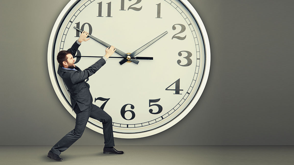 yelling businessman trying to stop a time. man and big clock over dark background