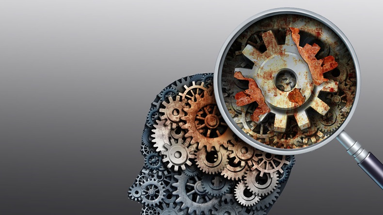 Brain decline and dementia or aging as memory loss concept for brain cancer decay or an Alzheimer's disease with old rusting mechanical gears and cog wheels in the shape of a human head with rust.