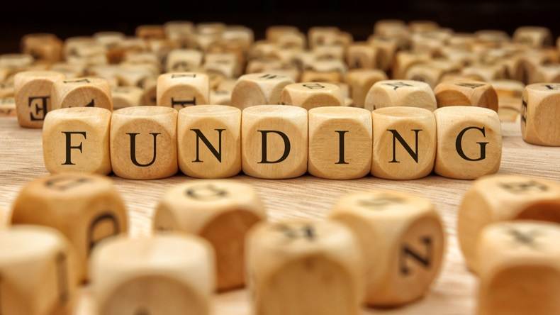 FUNDING word written on wood block